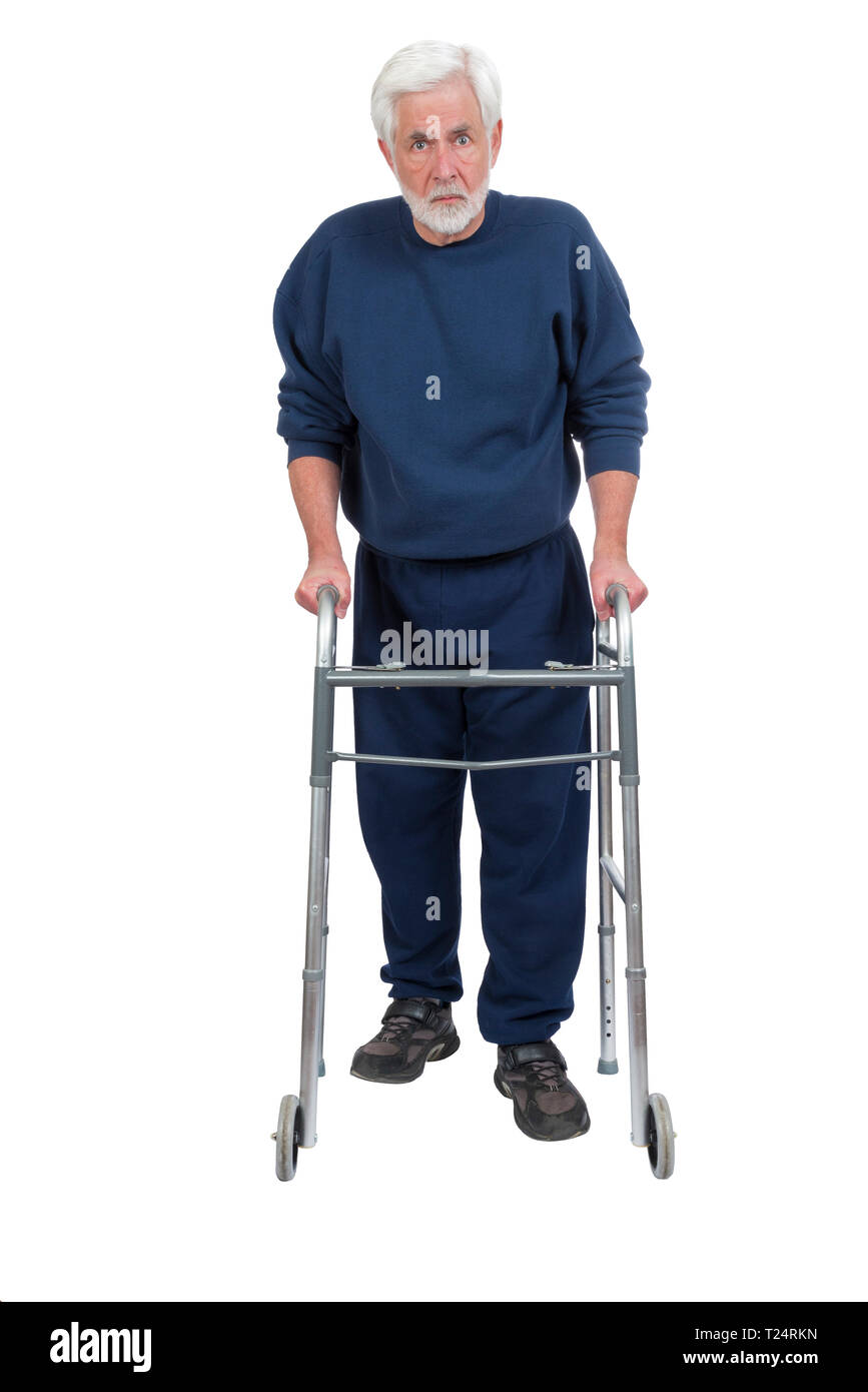 Vertical shot of an angry older man with walker isolated on white with copy space. - Stock Image