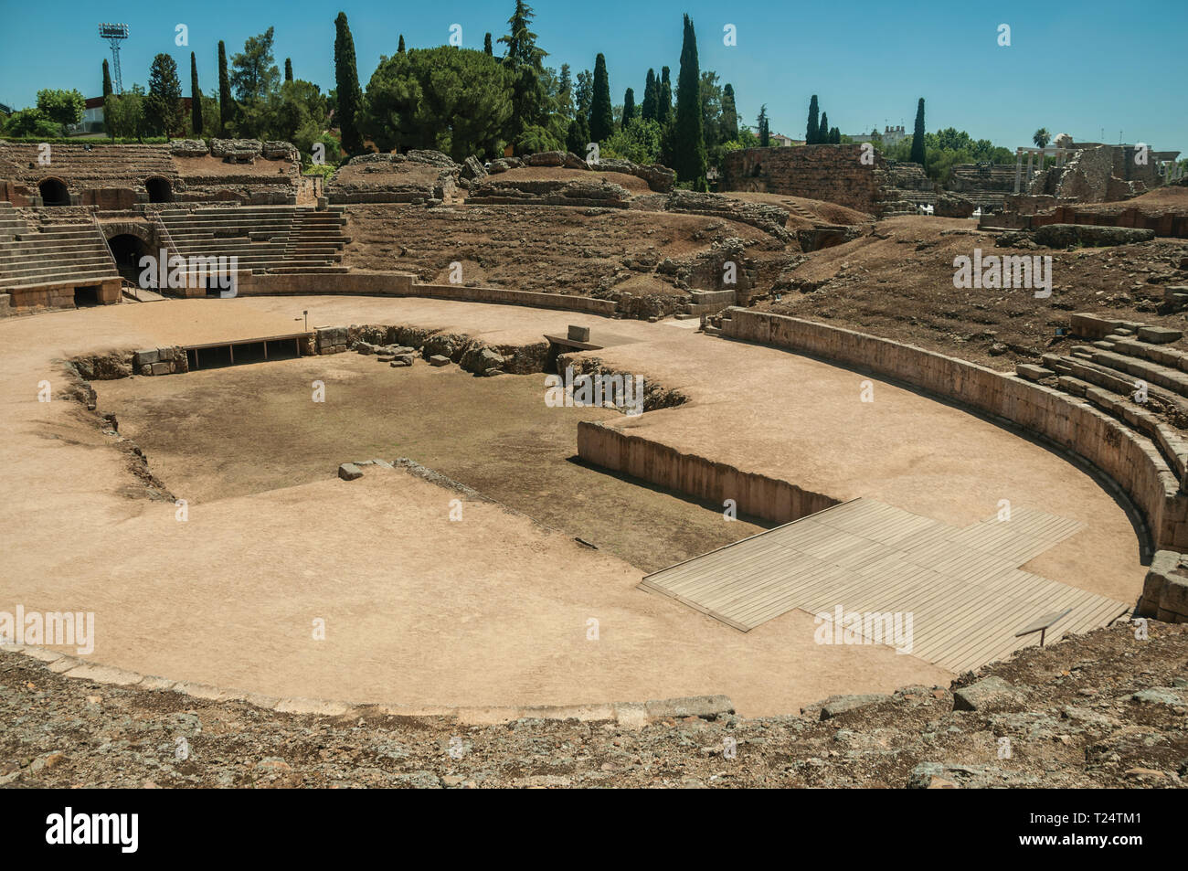 Stone bleachers and arena in the Roman Amphitheater at the archaeological site of Merida. The city preserves many buildings of ancient Rome in Spain. - Stock Image