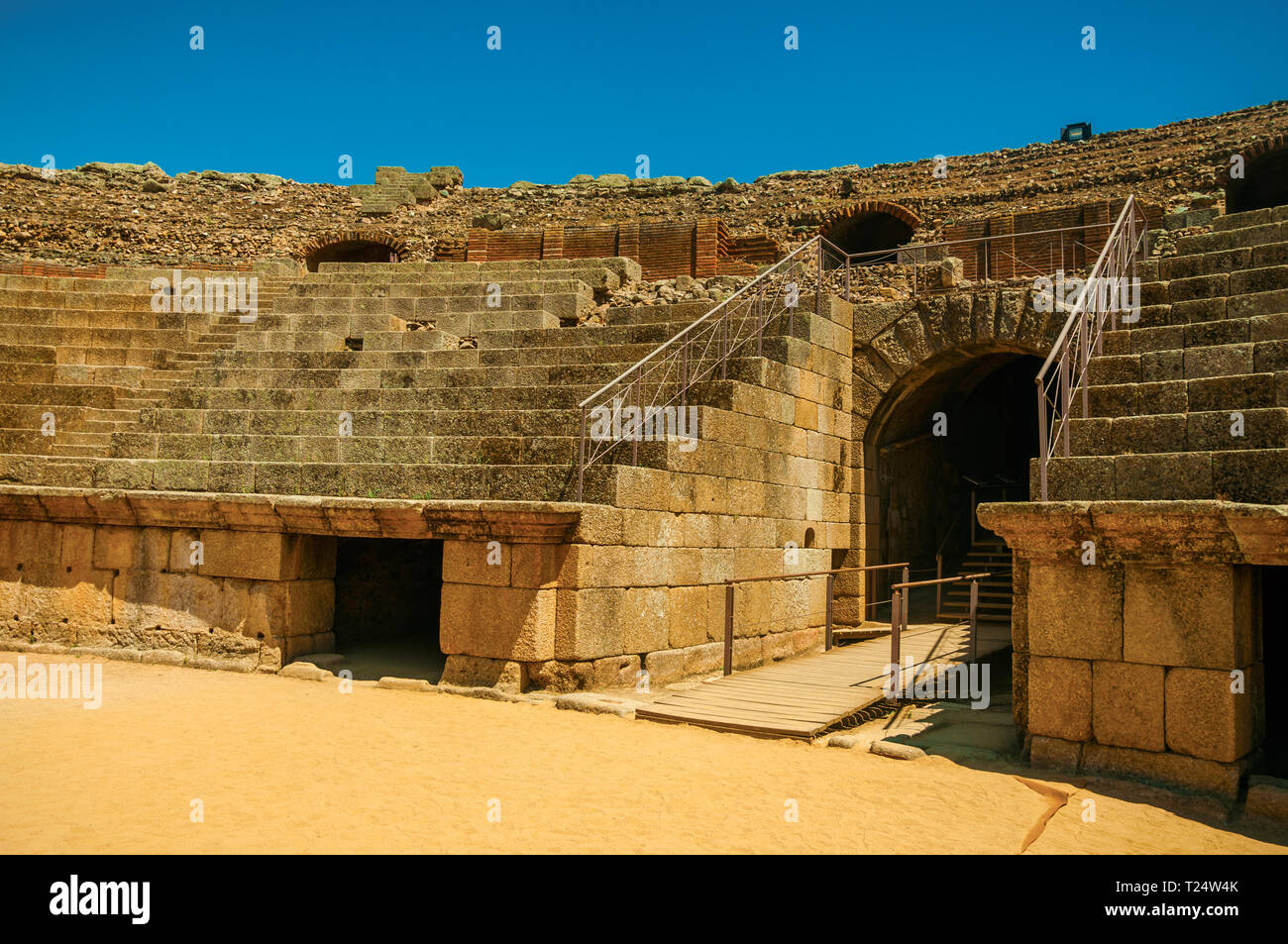 Exit in the bleachers of Roman Amphitheater at the huge archaeological site of Merida. The city preserves many buildings of ancient Rome in Spain. - Stock Image