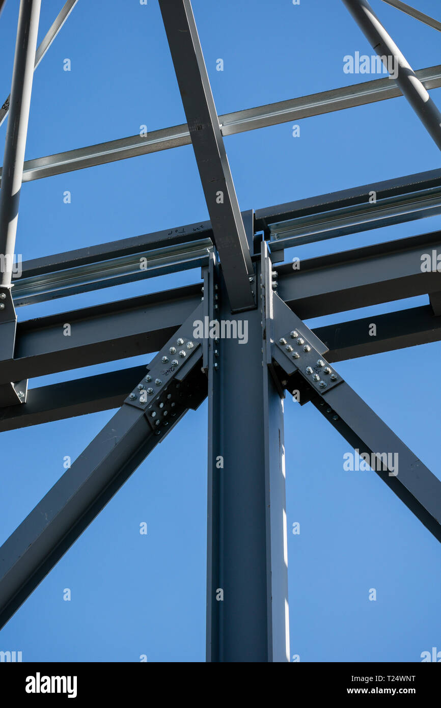Steel frame joint detail of new building in construction. Vertical shot Stock Photo