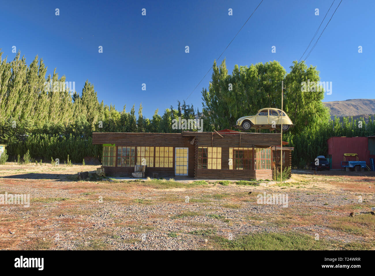 Car on top of a house, Chile Chico, Patagonia, Chile - Stock Image