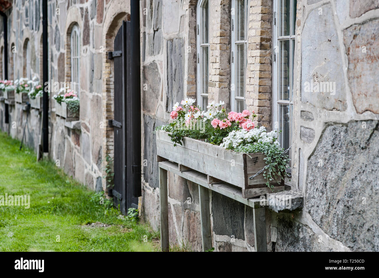 Wooden Window Flower Boxes With Pink Pelargonium And White Flowers Adorning Old Fashioned Stone Barn Stock Photo Alamy
