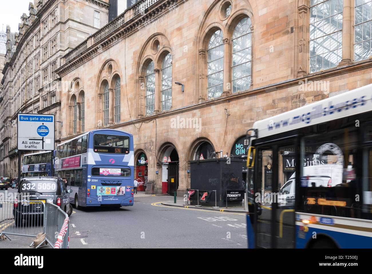 Hope Street Glasgow, Scotland's most polluted street - buses driving past Kerbside air quality monitoring site- Glasgow, Scotland, UK - Stock Image