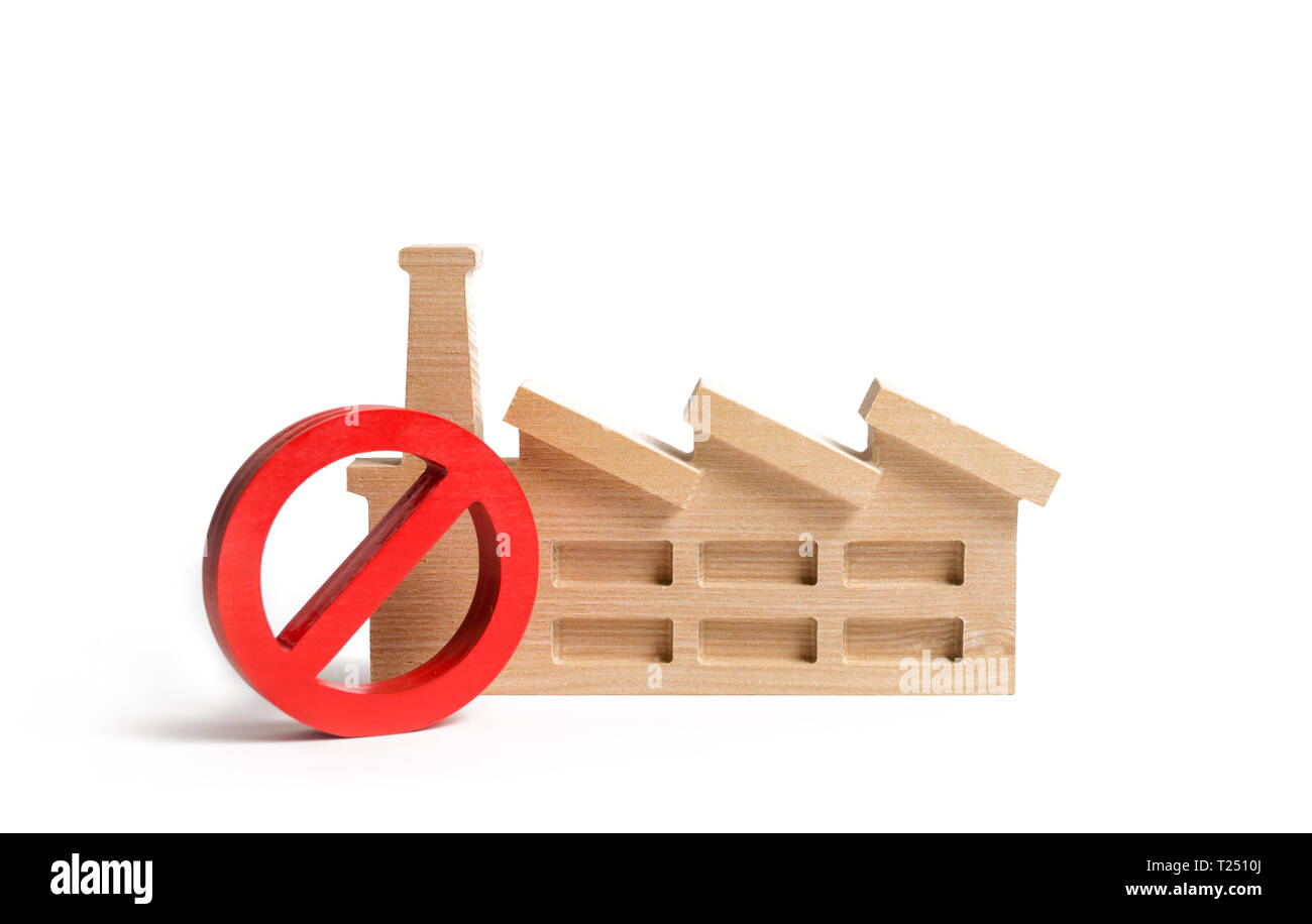 The red sign is NO and the plant or factory. The concept of a ban on the construction of hazardous industries. Environmentally friendly area. Closing  - Stock Image