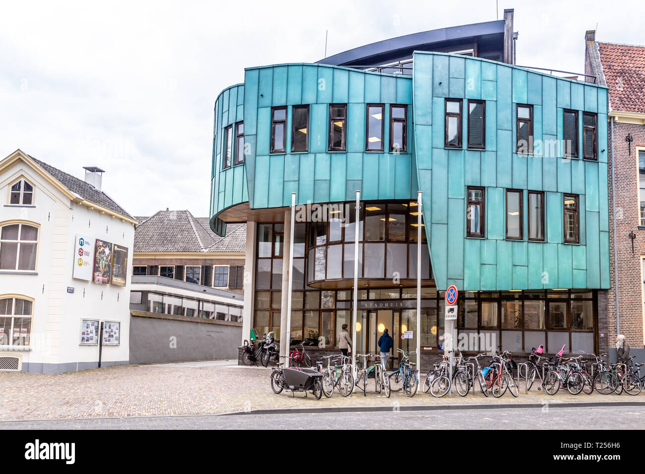 Zutphen, the Netherlands - March 28, 2019: Modern city hall with copper coating in the ancient city center of Zutphen in the Netherlands. Stock Photo