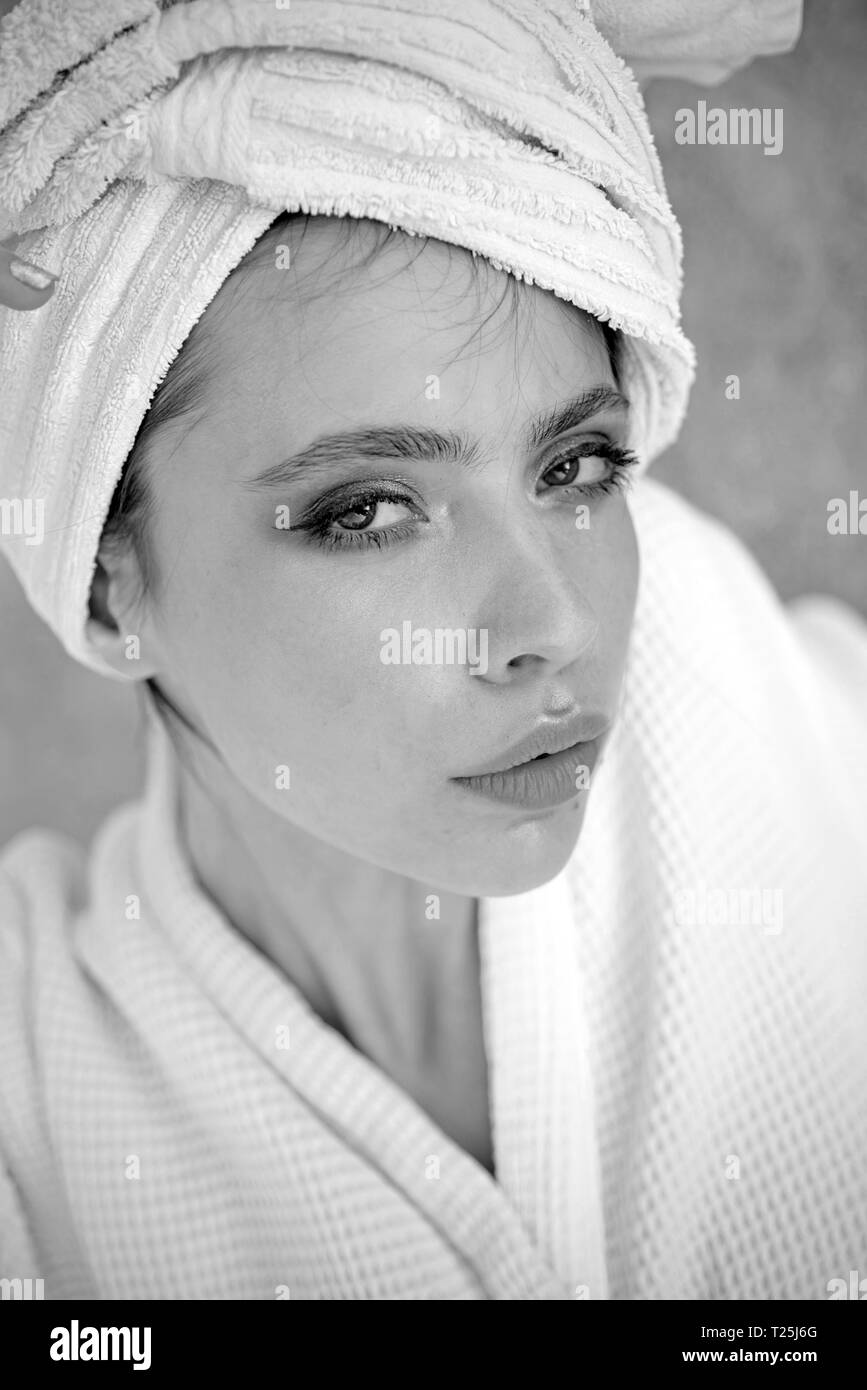Her haircare routine. Beauty routine and hygiene care. Pretty woman wear bath towel on head. Young woman in bathing gown. Skincare model after spa - Stock Image