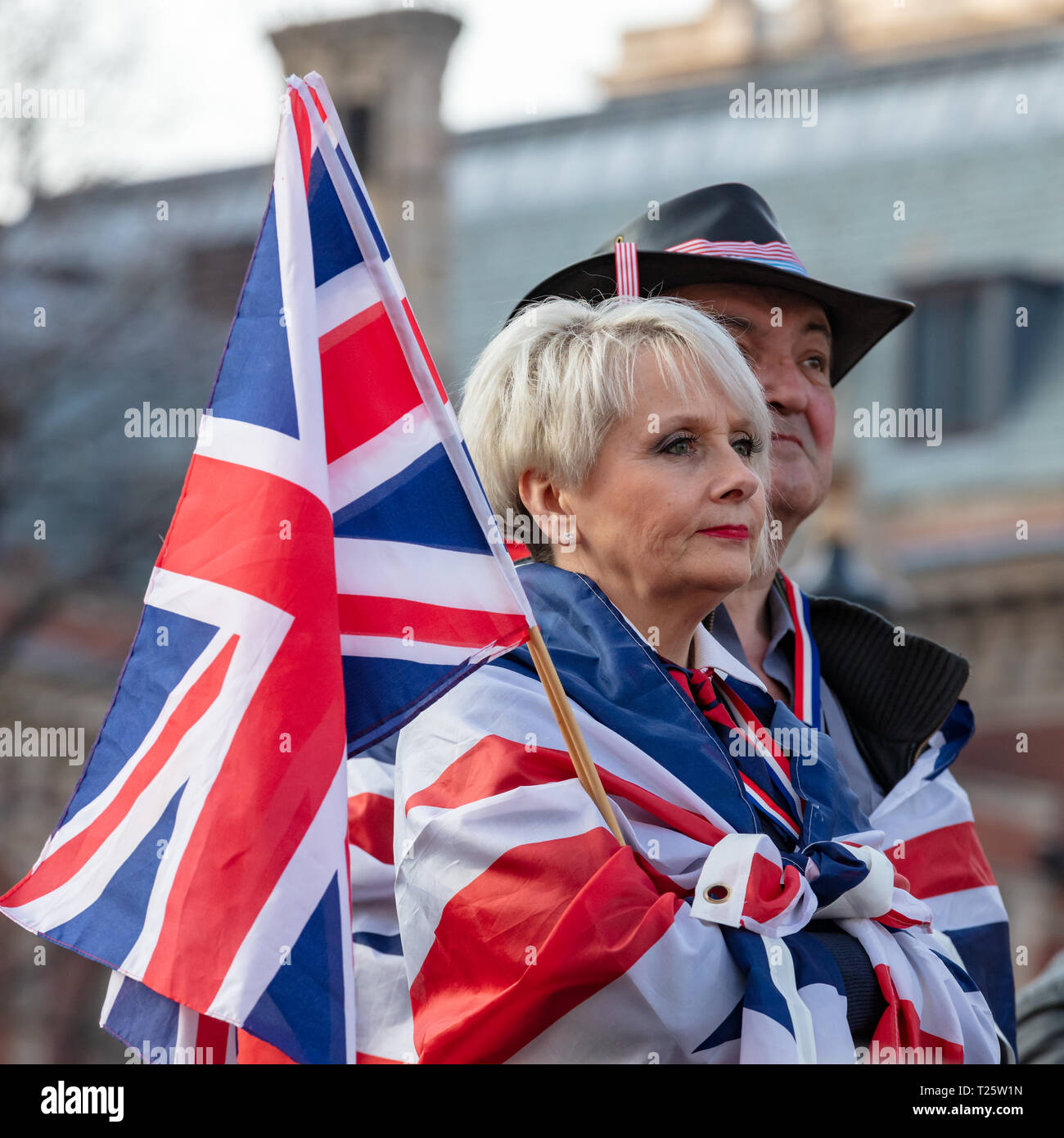 Westminster, London, UK; 29th March 2019; Female Pro-Brexit Demonstrator With Union Jacks Listens To Speeches During 'March to Leave' Rally. - Stock Image