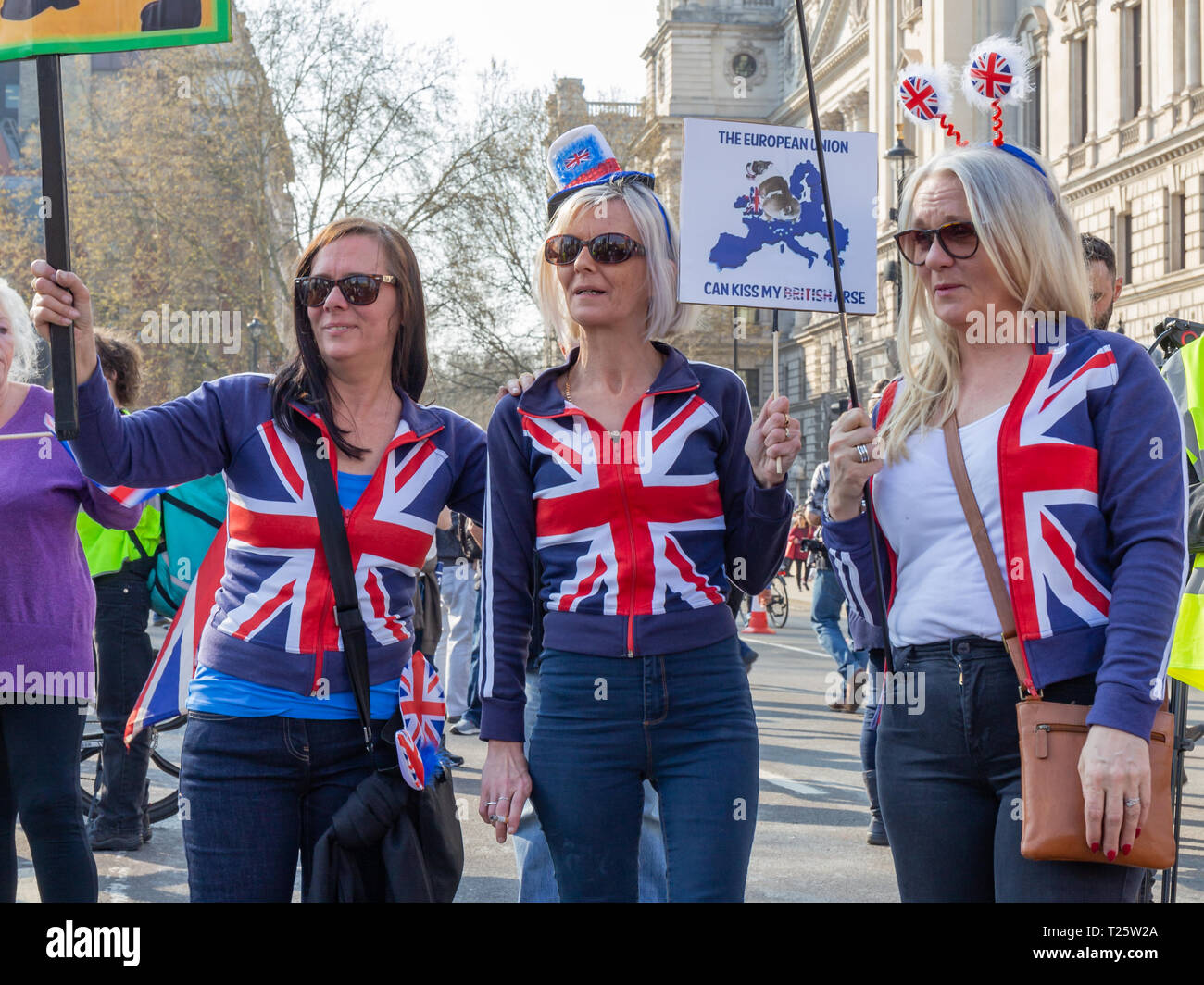 Westminster, London, UK; 29th March 2019; Three Female Pro-Brexit Demonstrator With Union Jack Clothing Pose for Photographers During March to Leave R - Stock Image