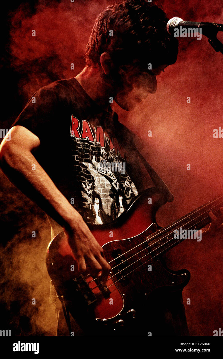 Bass guitar player in a rock festival - Stock Image
