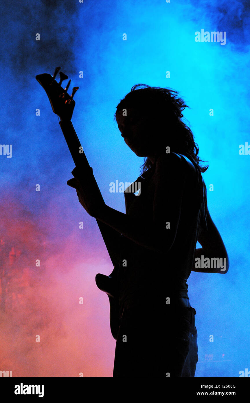 Bass player on pink and blue - Stock Image