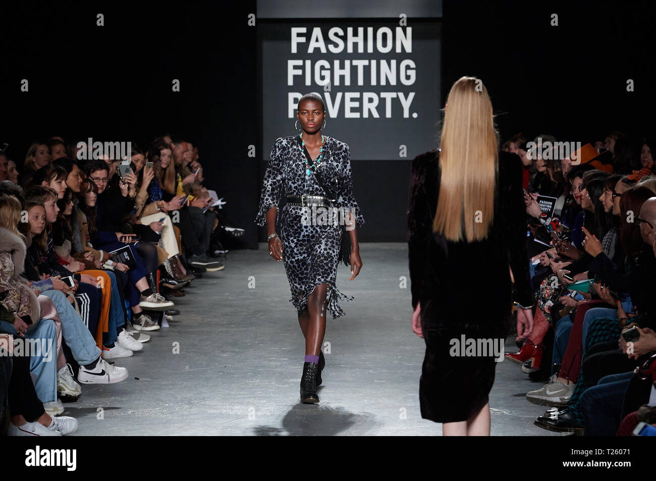 Models walking on the catwalk during the Fashion Fighting for Poverty for Oxfam Catwalk show held at Ambika P3, University of Westminster, 35 Marylebo - Stock Image