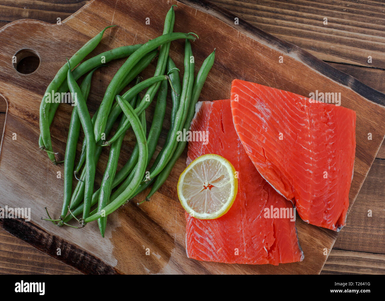 Sock eyed salmon with green beans and lemon - Stock Image
