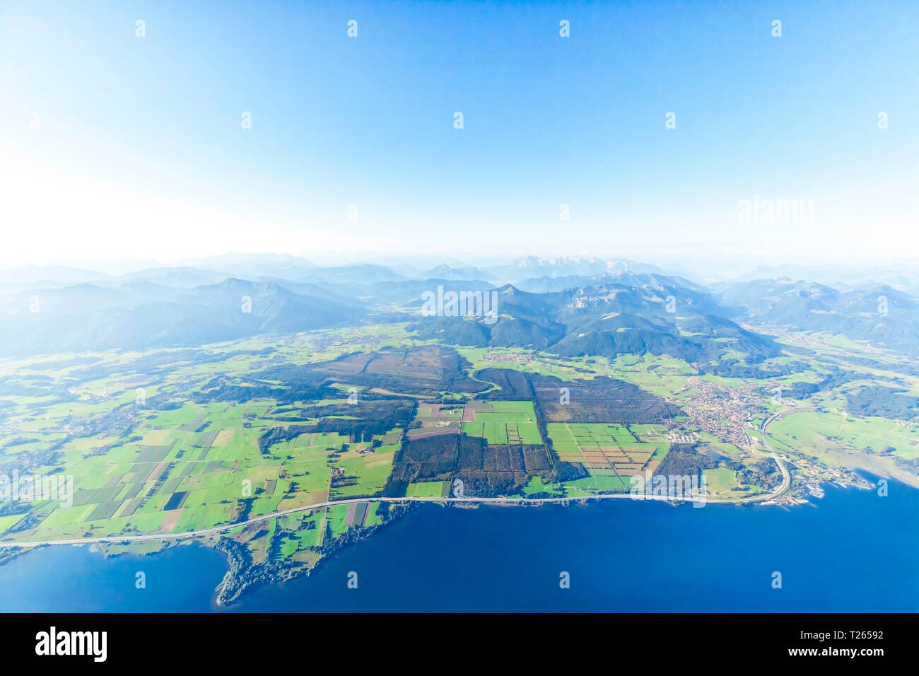 Germany, Bavaria, Chiemgau, Aerial view of Lake Chiemsee, Alps, A9 motorway and Bernau, Kampenwand and Alps in the background Stock Photo