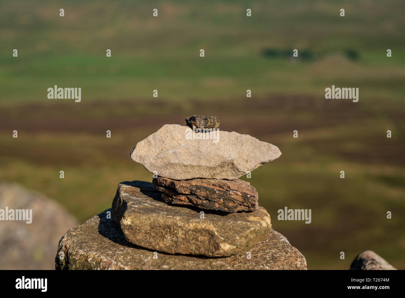 Stone stack on top of the Pen-Y-Ghent on the Pennine Way in the Yorkshire Dales between Halton Gill and Horton in Ribblesdale, North Yorkshire, Englan - Stock Image
