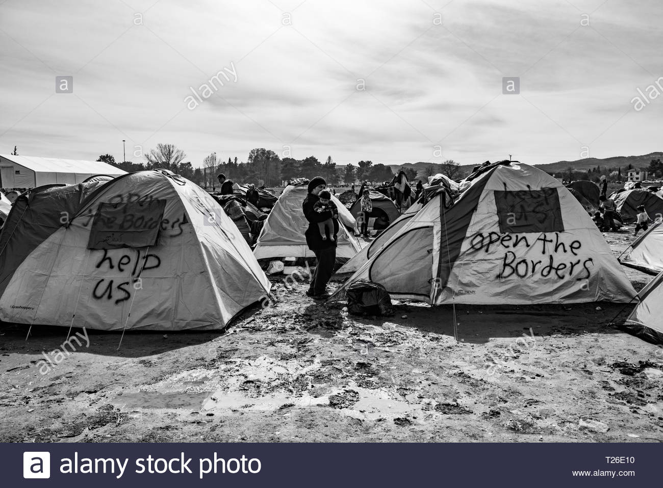 General view - the refugees sleep in overcrowded tents, hoping for the border to open at Greek-Macedonian border.  Idomeni, Greece, 8 March 2016.The refugee camp to which thousands of immigrants, mainly Syrians, are coming. It is occupied by people from different social strata. They are all found there fleeing the war, death and starvation. They continue their journey through Macedonia to the north and west of Europe. Not everyone manages to pass the verification of the documents, which leads to the separation of families. The refugees are living in difficult conditions. - Stock Image
