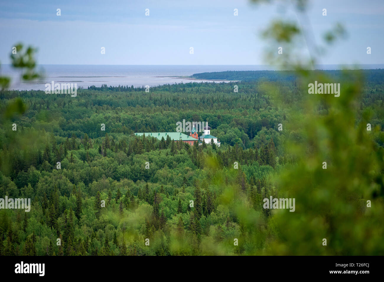 SOLOVKI, REPUBLIC OF KARELIA, RUSSIA - JUNE 27, 2018: View of the Holy Ascension monastery of the Solovki monastery, Savvatyevo from the top of the Se Stock Photo