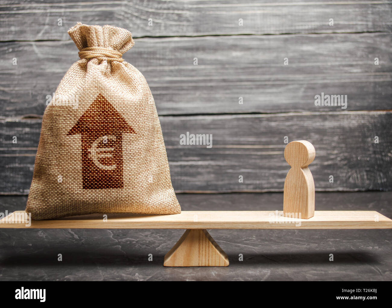 Euro money bag with up arrow and man figurine on scales. The average salary in the labor market, pricing. Criteria and requirements for increasing the - Stock Image