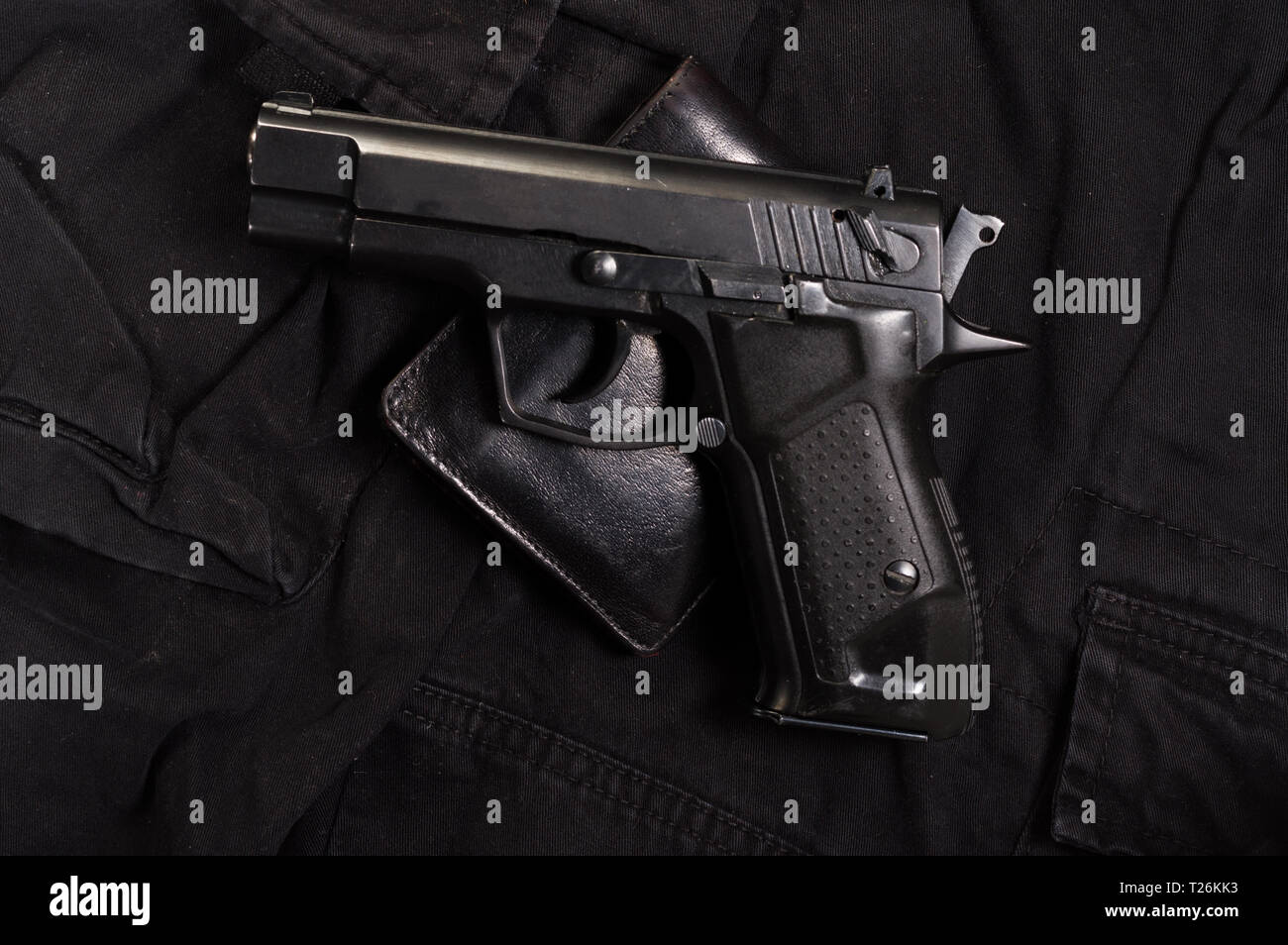 Pistol and leather wallet. Wallets and gun. Top view on the gun. - Stock Image