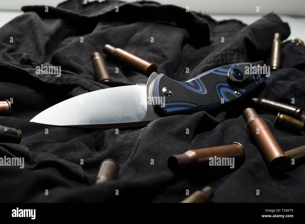 Knife ammunition on a black background. Military sleeves and knife. Front view. - Stock Image