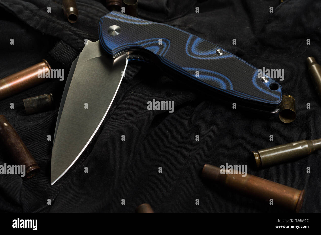 Folding knife. Knife in a half-complicated position. Front view. - Stock Image