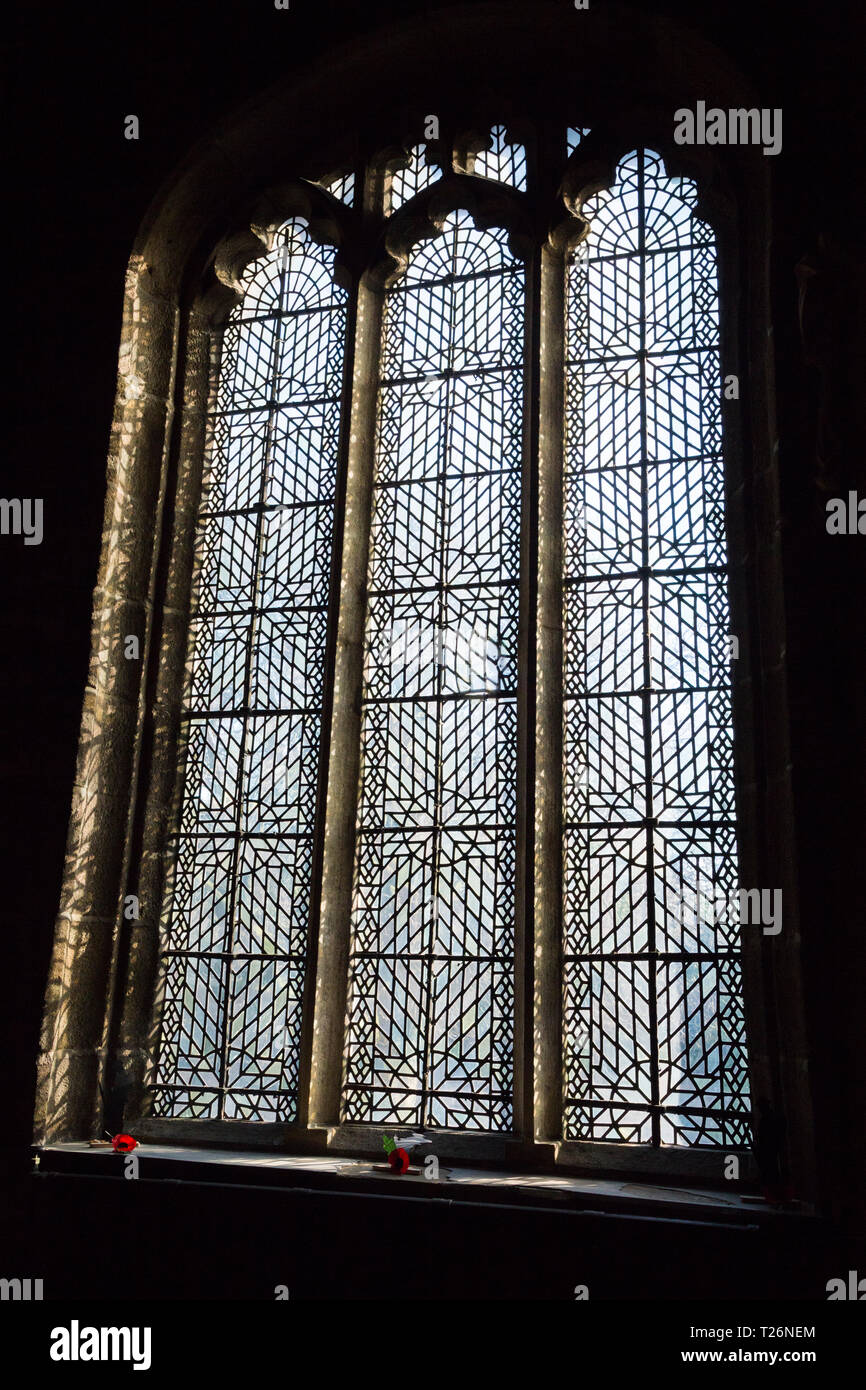 Commonwealth glass windows of Halifax Minster. West Yorkshire. UK.  Plain glass leaded windows were installed during the Commonwealth (1649–1660). - Stock Image