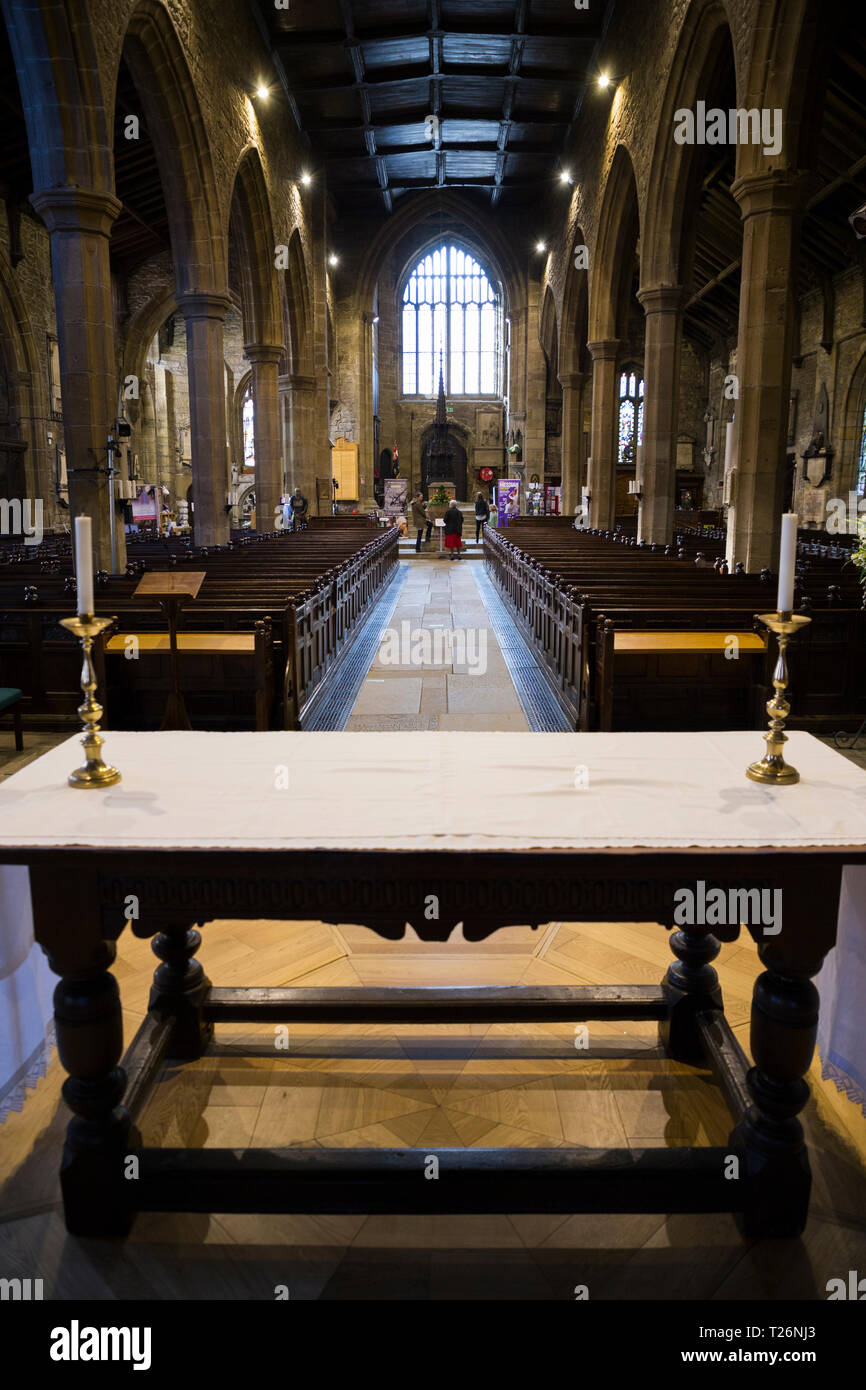 The Nave / interior / inside Halifax Minster, UK, seen from the East End / Chancel, looking over altar table to West End, Tower & Baptismal Font. (106 Stock Photo