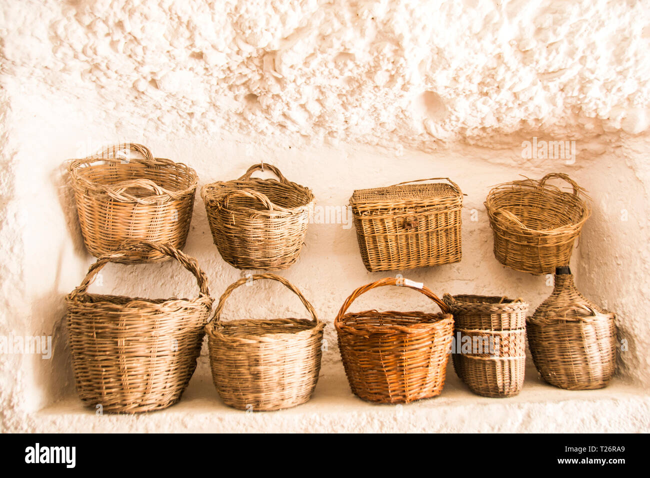 A grouping of woven baskets for sale; Granada, Spain - Stock Image
