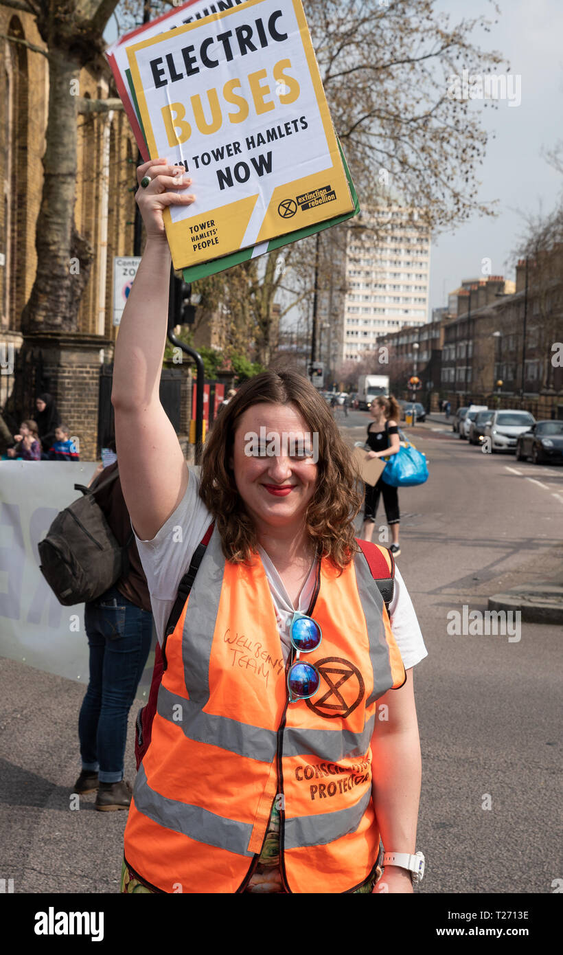 Bethnal Green,London, UK. 30th March 2019. Extinction Rebellion environmental protest and road blockade of junction of Cambridge Heath Road and Roman Road in Bethnal Green. . Organised by Extinction Rebellion Tower Hamlets. Credit: Stephen Bell/Alamy Live News. - Stock Image