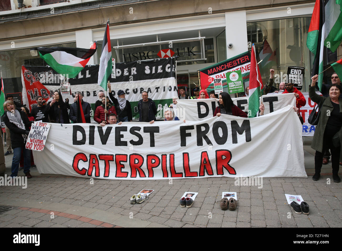 Manchester, UK. 30th March 2019. A rally and march for Palestine demanding 'freedom, justice and equality' for the Palestinian people.  March 30th is Palestinian Land Day, when Palestinians across the world remember the protesters killed in the struggles. Today also marks the 1st anniversary of the start of the Great Return March. Pro Palestinian campaigners arranged the solidarity march protesting outside Barclays and HSBC Banks calling on them to divest from doing business with companies selling military equipment and technology which they say are used in human rights violations.  Manchester - Stock Image