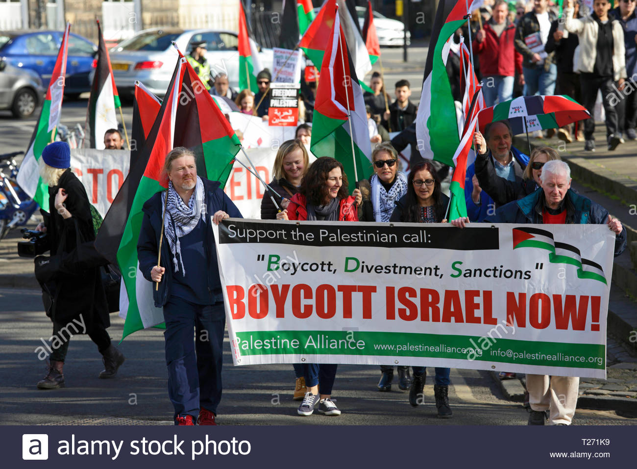 Edinburgh, Scotland, UK. 30th March 2019.  In Charlotte Square approaching Bute House, official residence of the First Minister.  Demonstration of solidarity with the Palestinian people on 30th March, Land Day, which also marks one year since the start of the Gaza Great March of Return. On Land Day in 2018, Palestinians in Gaza began their Great March of Return calling for the lifting of Israel's 11-year illegal blockade on Gaza and for the right of Palestinian refugees to return to their villages and towns. Credit: Craig Brown/Alamy Live News - Stock Image