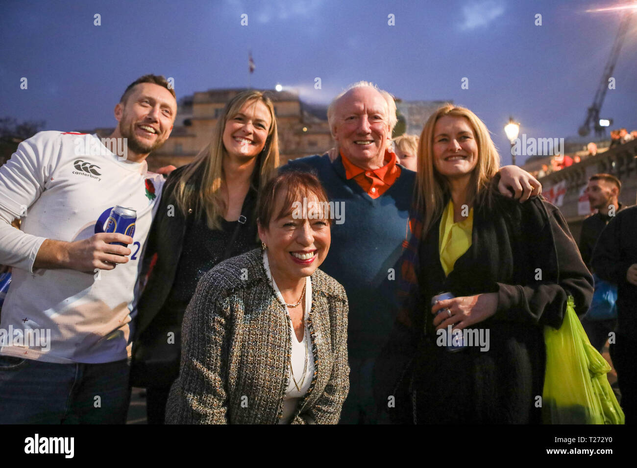 London, UK. 30th March, 2019. Mayor of Sunderland Lynda Scanlan, center, with member of Sunderland's 1973 FA Cup winning team, Micky Horswill, 2nd right, Travelling Sunderland supporters on the evening before their EFL Trophy final against Portsmouth at Wembley take over Trafalgar Square. Penelope Barritt/Alamy Live News - Stock Image