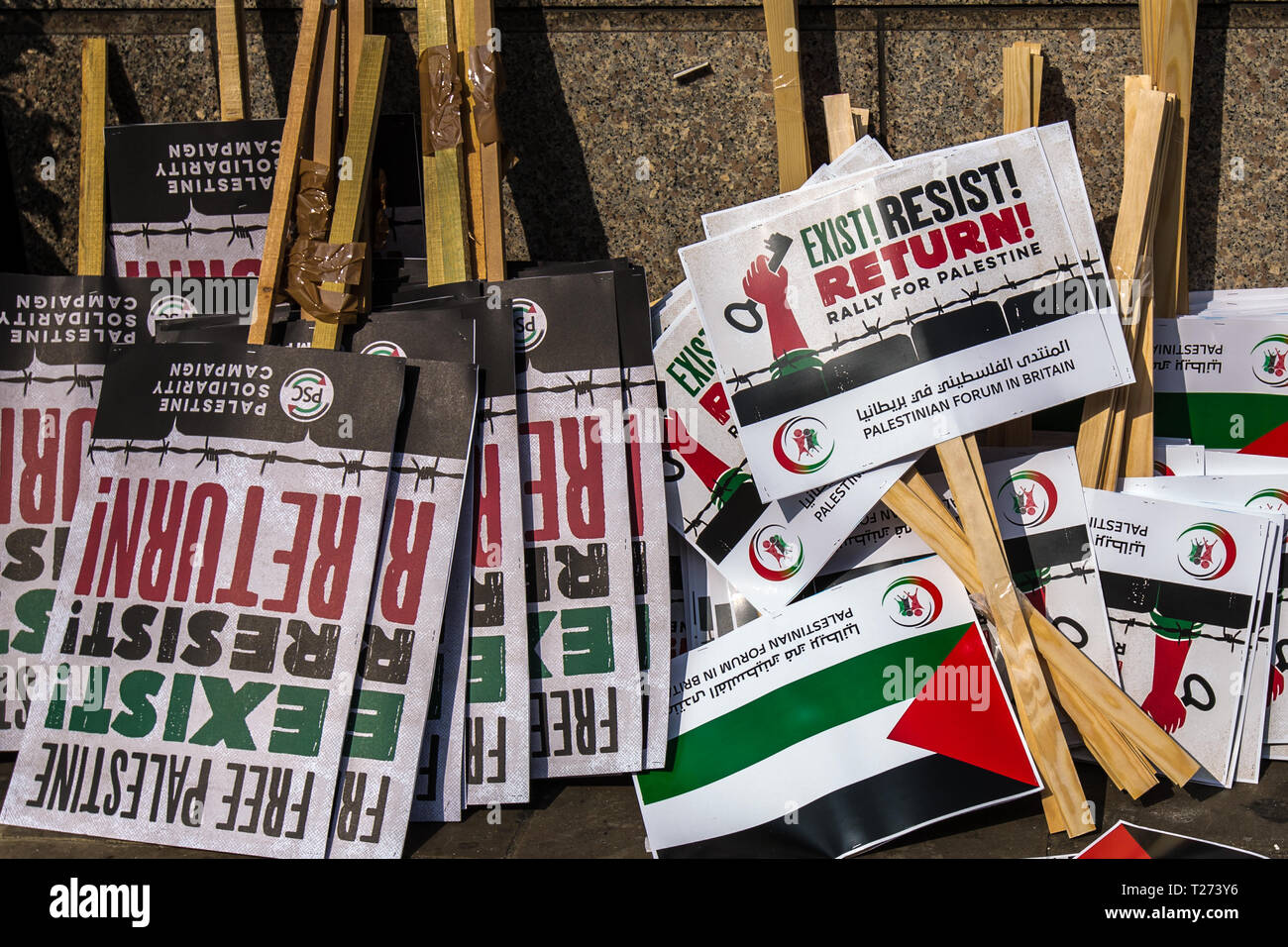 London, UK. 30 March, 2019. Placards at the rally, Exist Resist! Return! Palestinians and supporters gathered outside of the Israeli Embassy in London to mark the beginning of Nakba and to call on the global community to hold Israel to account for their violation of human rights and International law. David Rowe/ Alamy Live News. - Stock Image