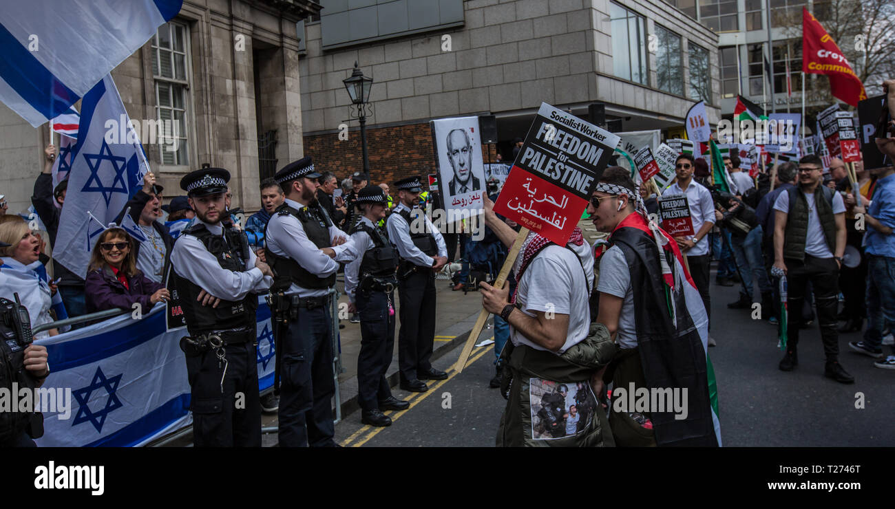 London, UK. 30 March, 2019. A small Pro Israeli counter protest. Palestinians and supporters gathered outside of the Israeli Embassy in London to mark the beginning of Nakba and to call on the global community to hold Israel to account for their violation of human rights and International law. David Rowe/ Alamy Live News. - Stock Image
