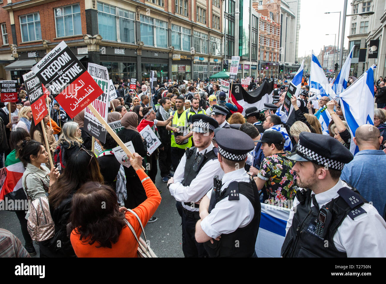 London, UK. 30th March, 2019. Pro-Palestinian campaigners attending a Rally for Palestine outside the Israeli embassy to demand freedom, justice and equality for the Palestinian people stand in front of a small pro-Israel counter-protest Credit: Mark Kerrison/Alamy Live News Stock Photo