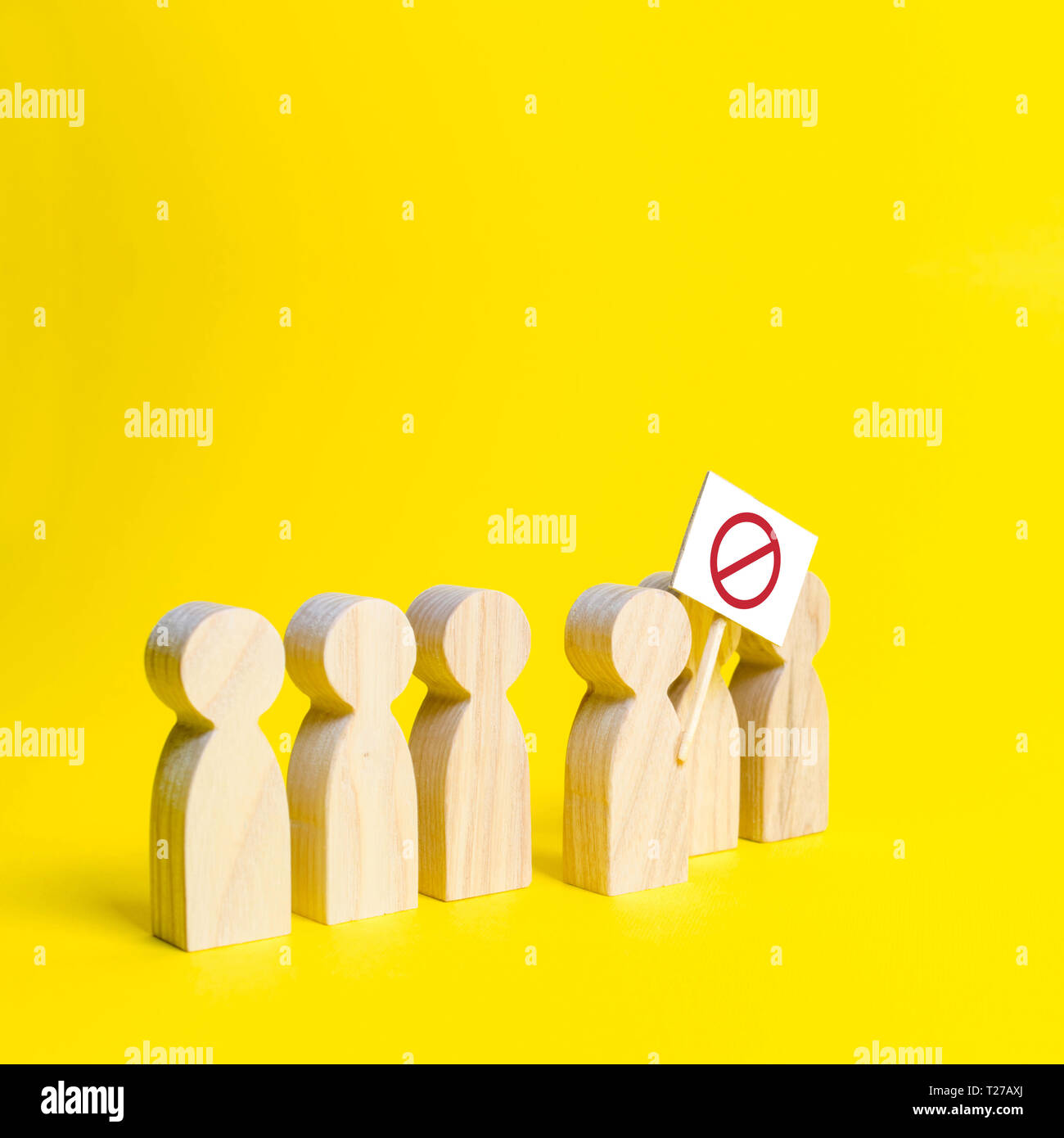 The person's figure comes out of the line with a sign on an yellow background. Social discontent and social tension, protest and disagreement. An angr - Stock Image