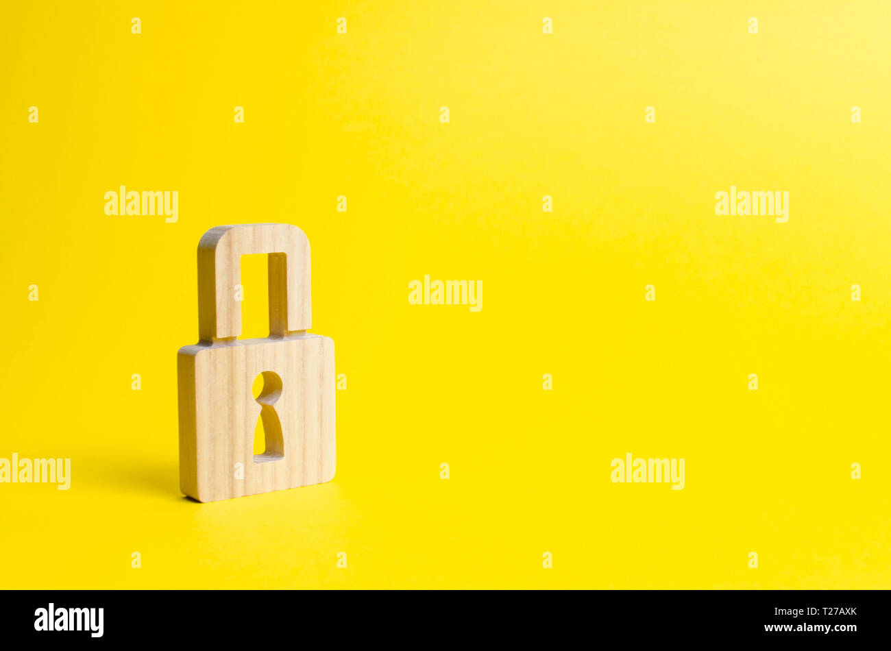 A padlock on a yellow background. information safty. concept of the preservation of secrets, information and values. Hacking attack, hacking. Protecti - Stock Image