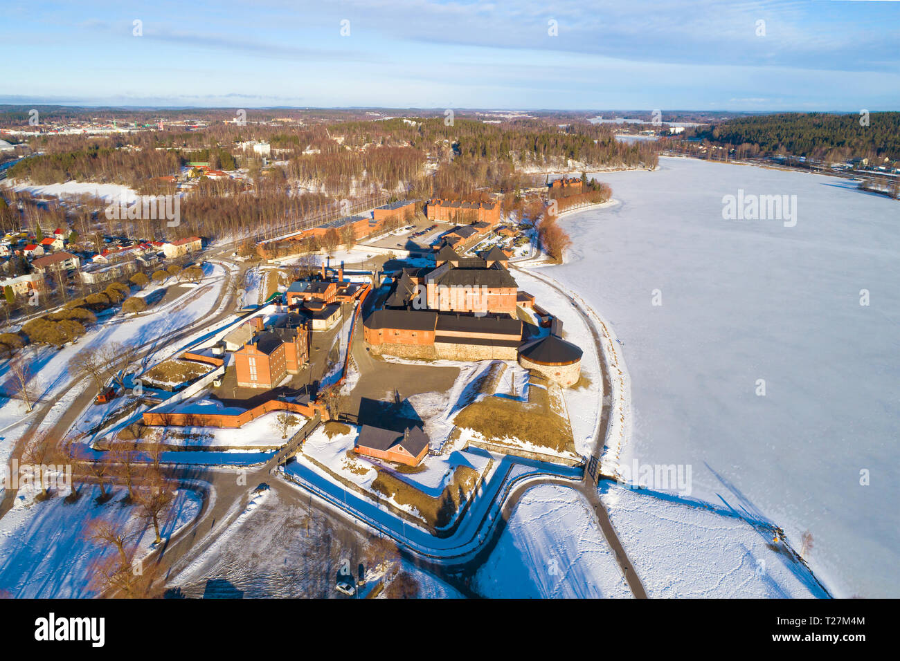 A view from the heights of the ancient fortress of the Hameenlinna city on a March morning (aerial survey). Finland Stock Photo