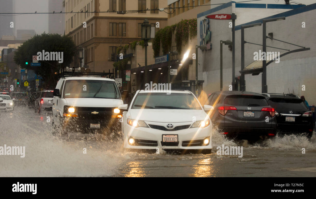 FEB 2, 2019 - LA CA USA - Car driving through deep water in downtown LA, CA during strong rainstorm - Stock Image