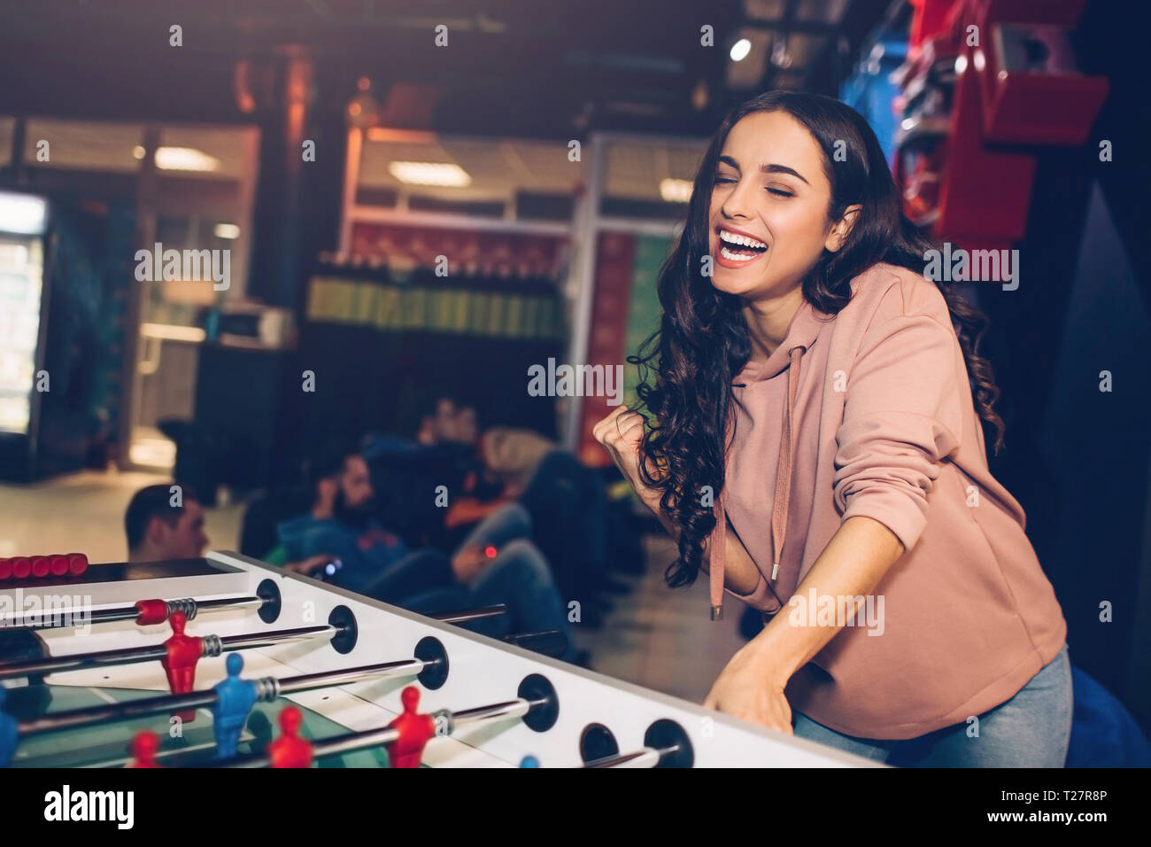 Young Attractive Woman Stand In Playing Room And Play Table
