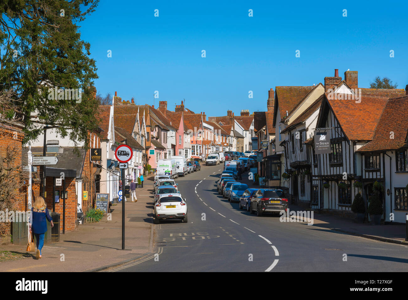 Lavenham Suffolk, view in summer of old buildings and shops lining both sides of the High Street in Lavenham, Babergh district, Suffolk, England, UK. - Stock Image