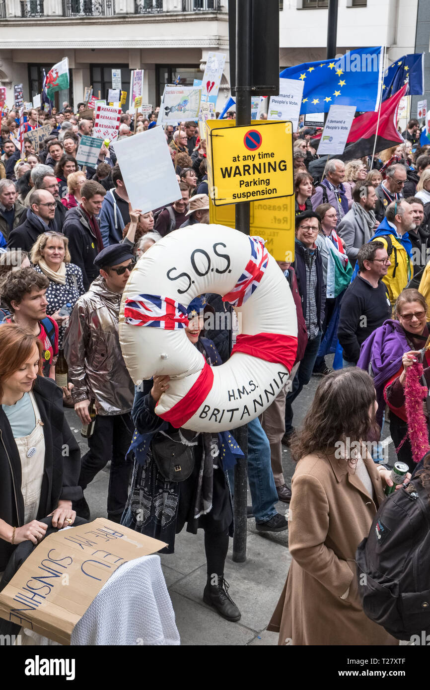 London, UK, 23rd March 2019. A million protestors march against Brexit and in support of a second referendum. A protestor wearing a giant lifebelt Stock Photo