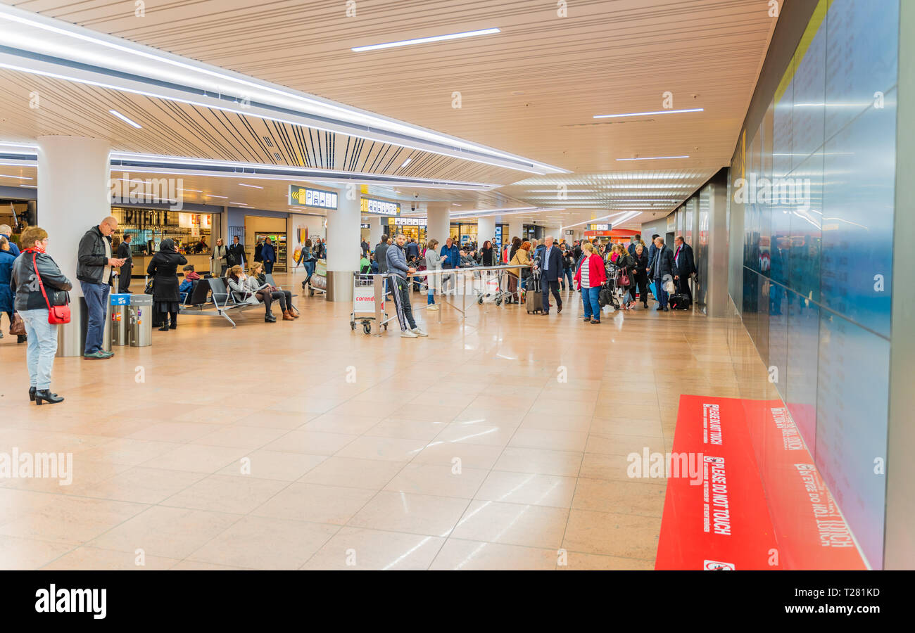 Brussels, Belgium, March 2019 Brussels airport, people meeting their friends and family in arrival area - Stock Image