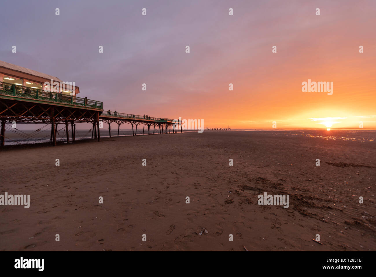 St Anne's Pier, a Victorian pier, at sunset in the English seaside resort of St Anne's-on-the-Sea, Lytham St Annes, Lancashire, UK - Stock Image