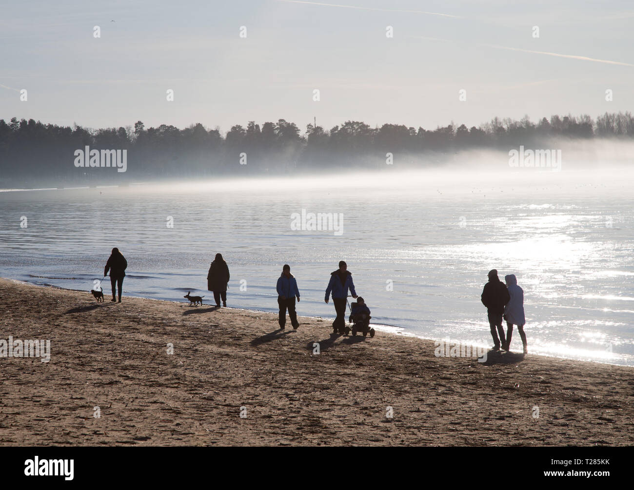 People on Sunday walk. - Stock Image