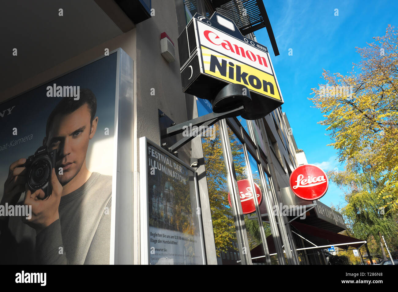 Camera Shop with adverts for Canon Nikon Leica in Berlin Germany - Stock Image