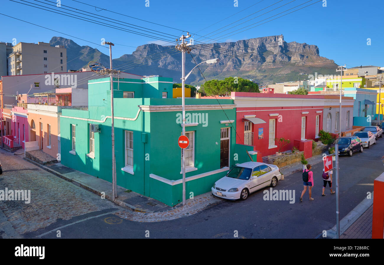 View from higher of colorful houses and streets of Bo Kaap, with Table Mountain in background. Cape Town, South Africa, March 21, 2019. Stock Photo