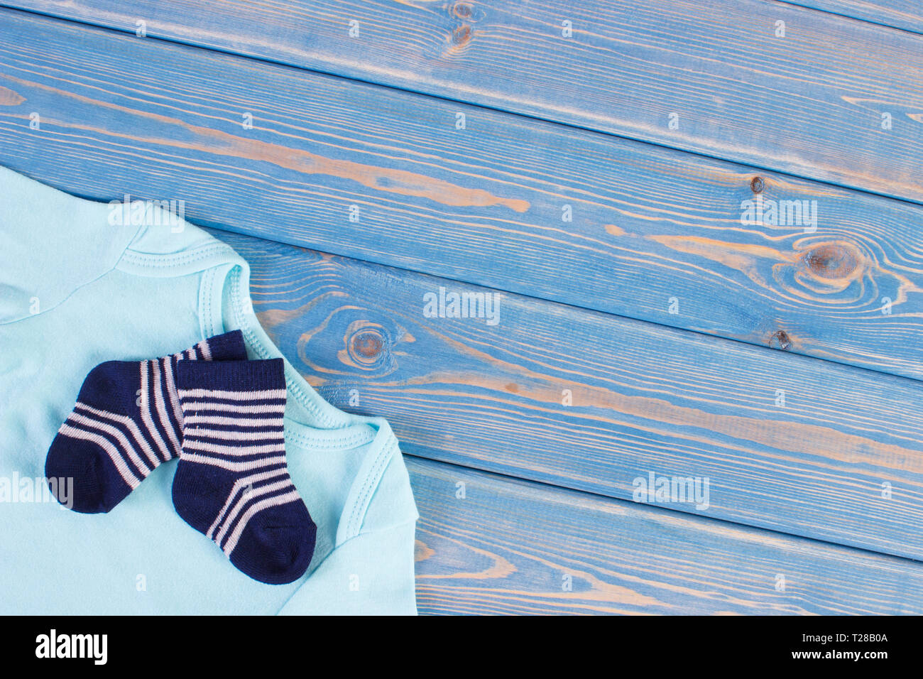 Clothes for little baby boy, extending family concept, copy