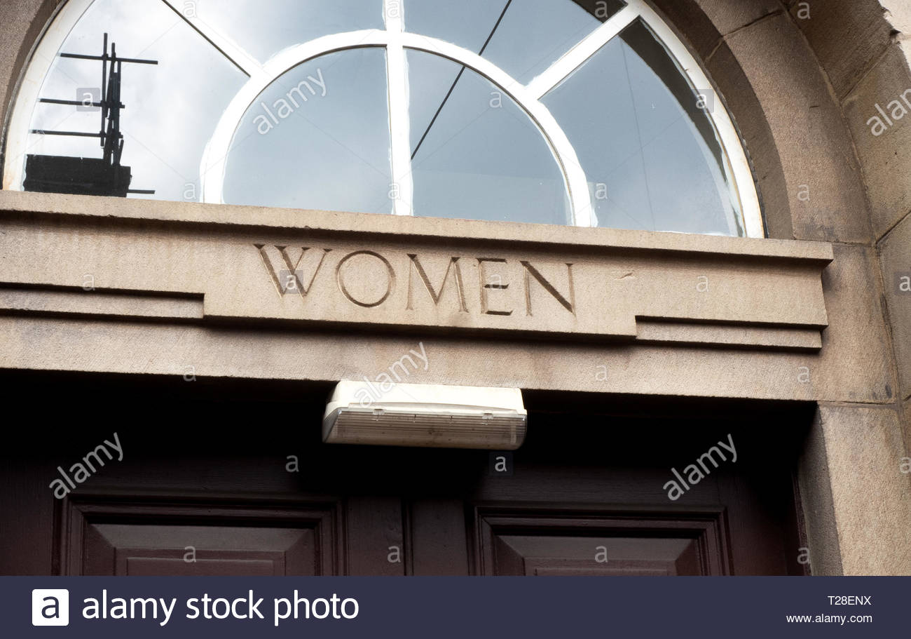 The 'Women' only entrance at the job centre in Sheffield depicting the segregation of days gone by when women were not treated as equals in England... Stock Photo