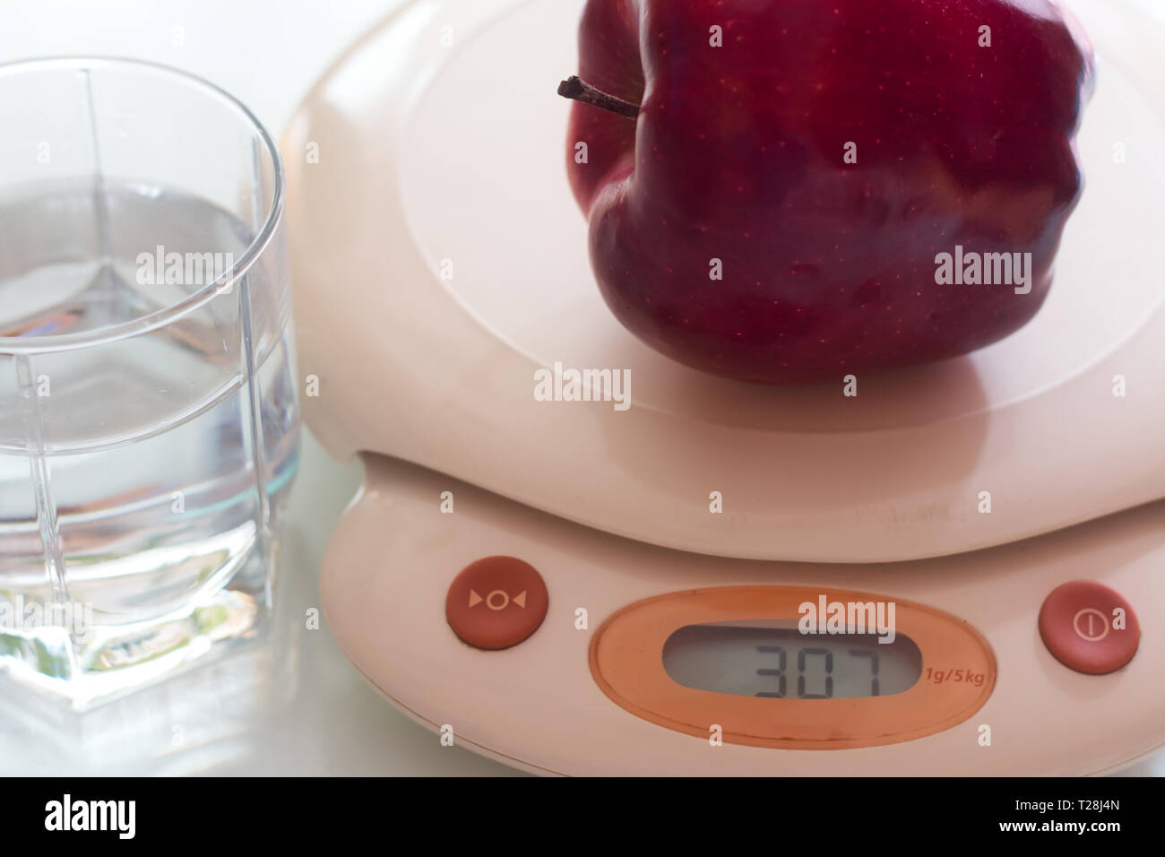 Dieting concept. Weigh the food Stock Photo