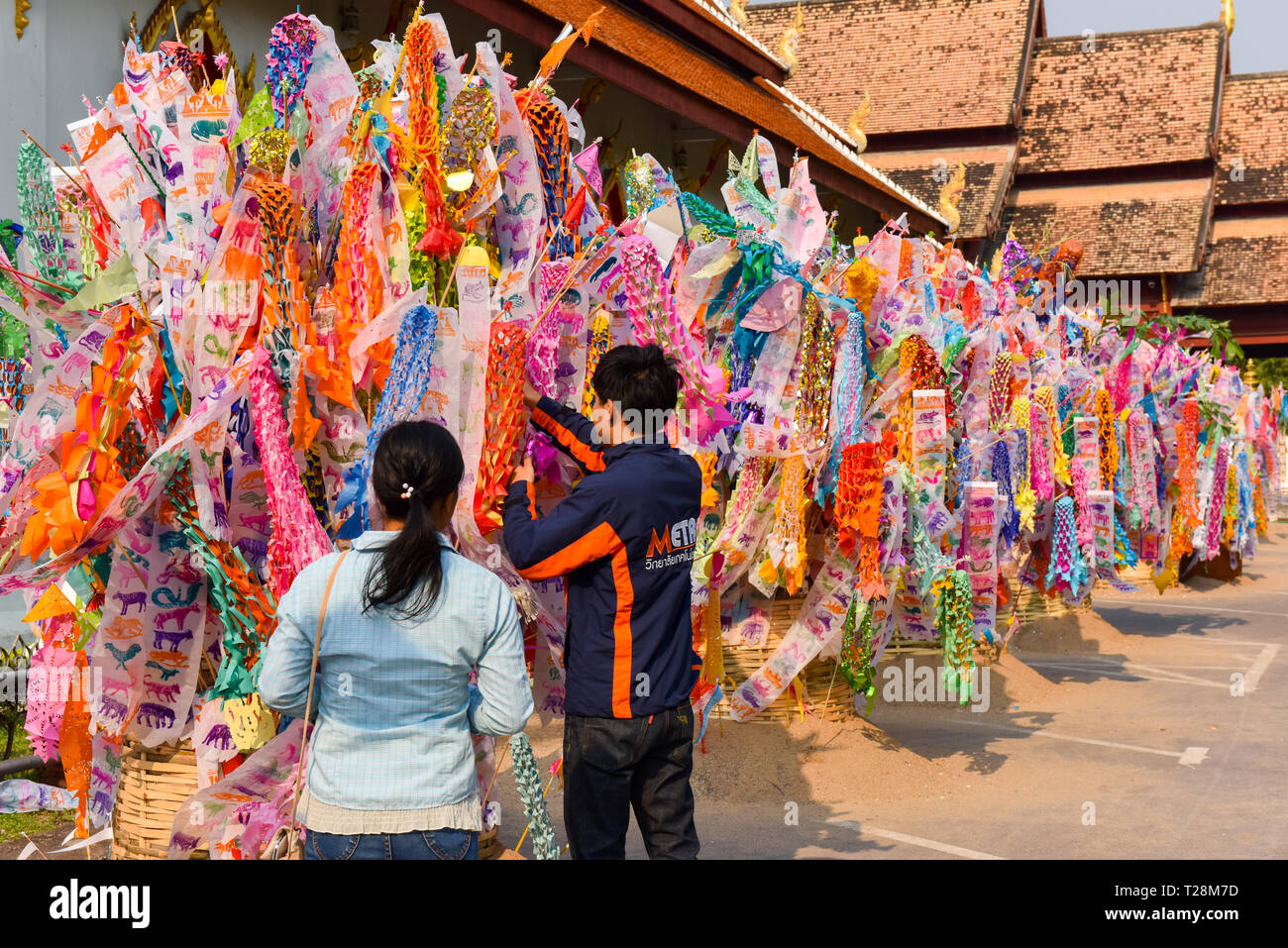 People at the temple for Songkran celebrations (Thai New Year) , Chiang Mai, Thailand - Stock Image